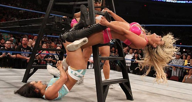 Gail Kim applies a figure four leg lock to Taryn Terrell - on a ladder!