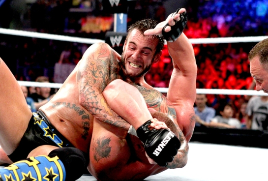 CM Punk applies the Anaconda Vice to Brock Lesnar