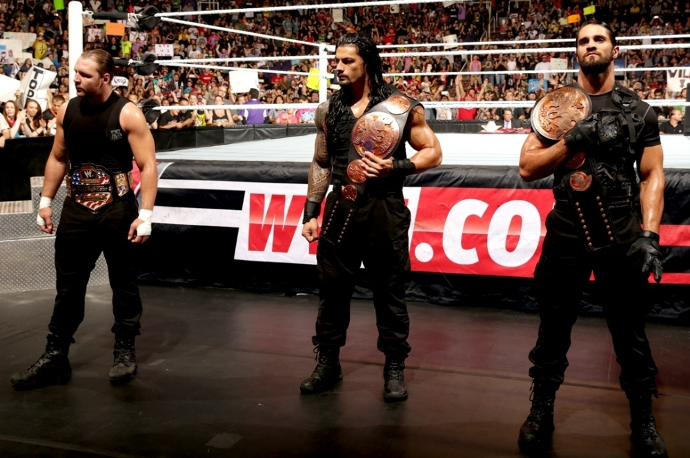 The Shield: Dean Ambrose (left), Roman Reigns (center), Seth Rollins (right)